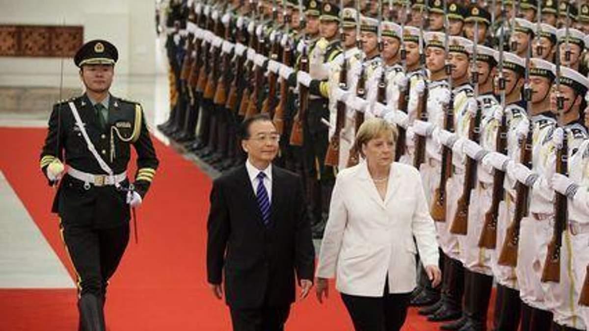 Меркель будет уговаривать Китай сократить импорт нефти из Ирана