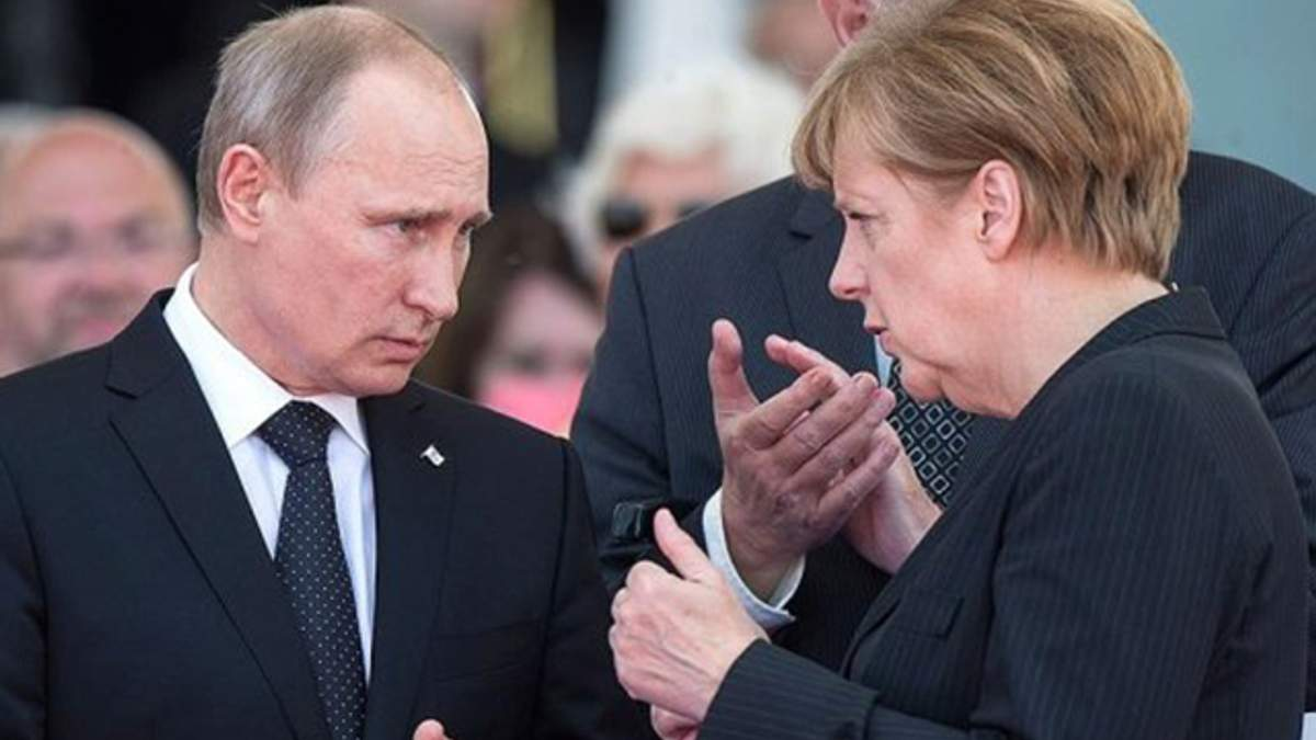 Меркель с Путиным говорили о политзаключенном Сенцове