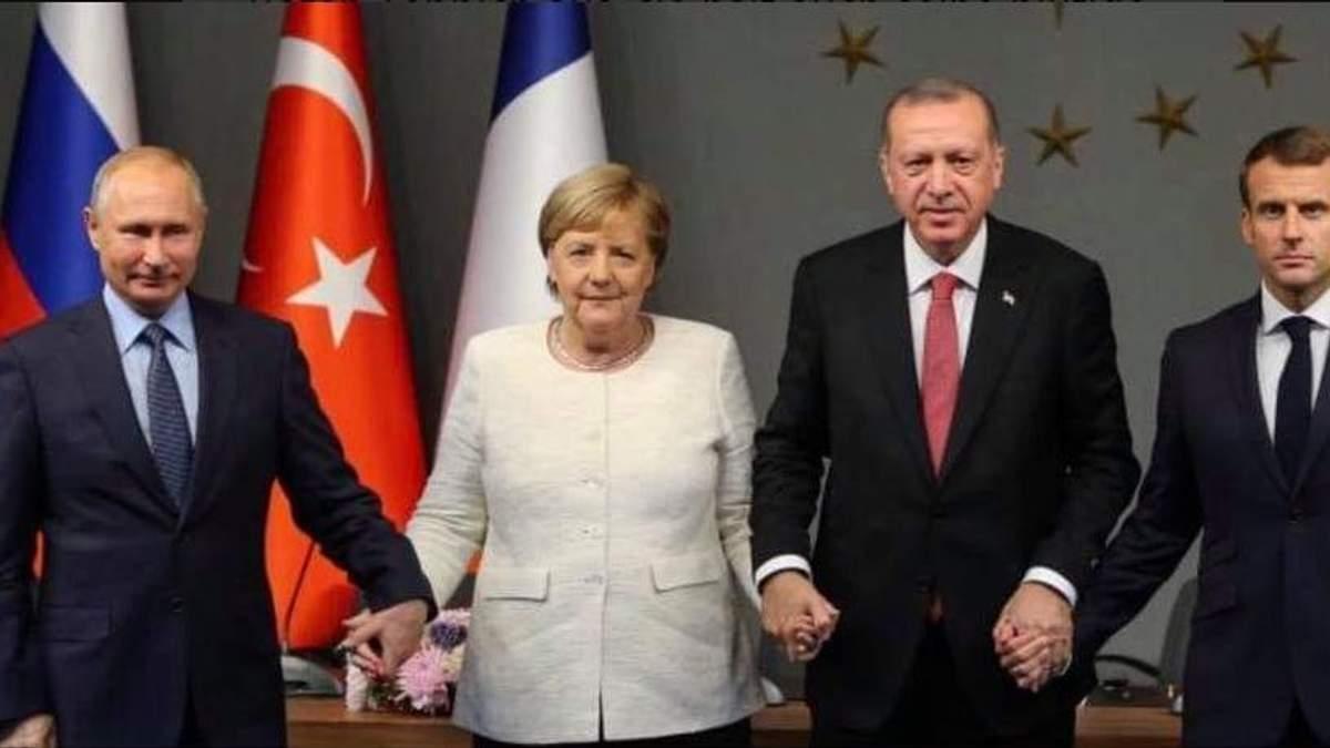 Меркель у Німеччині розкритикували за палкі рукостискання із Путіним та Ердоганом