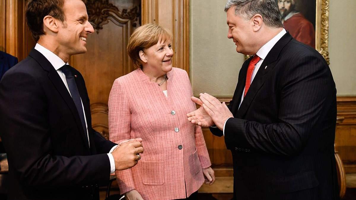 Порошенко домовився з Меркель і Макроном забезпечити безпеку для проведення місцевих виборів на Донбасі