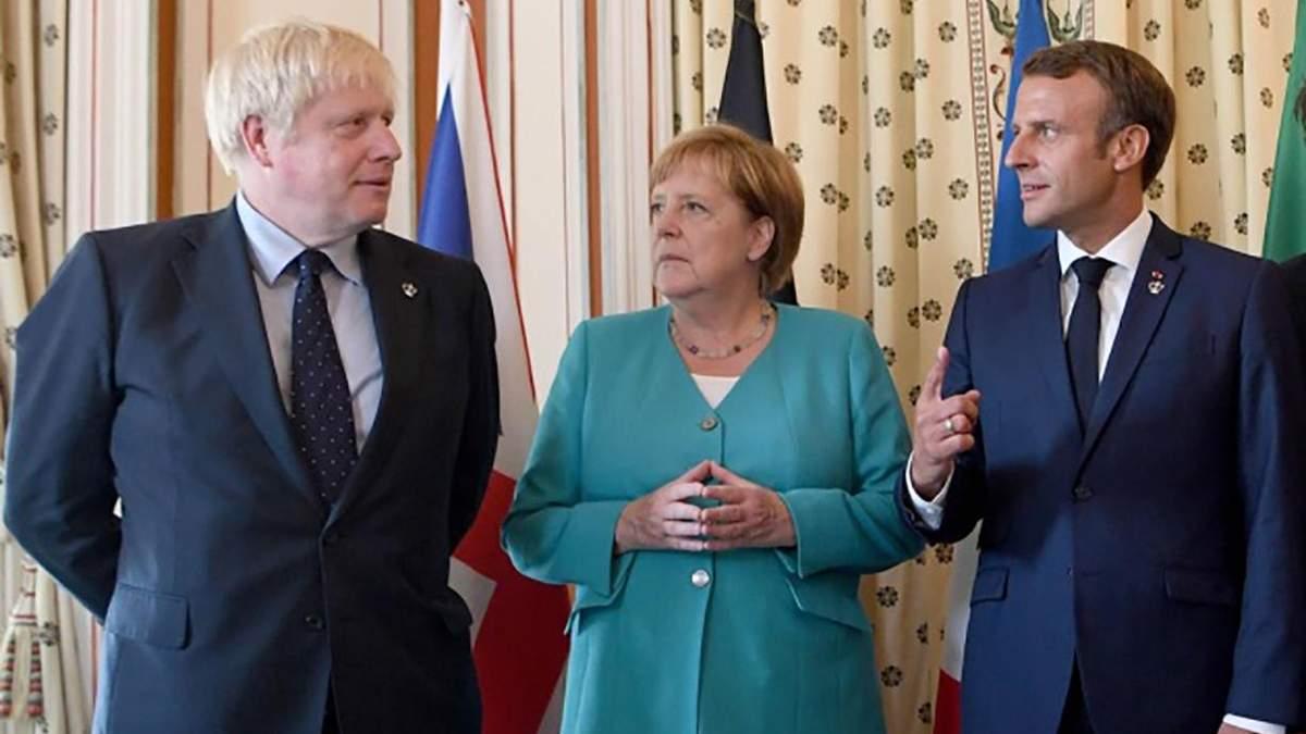 Борис Джонсон, Ангела Меркель і Еммануель Макрон