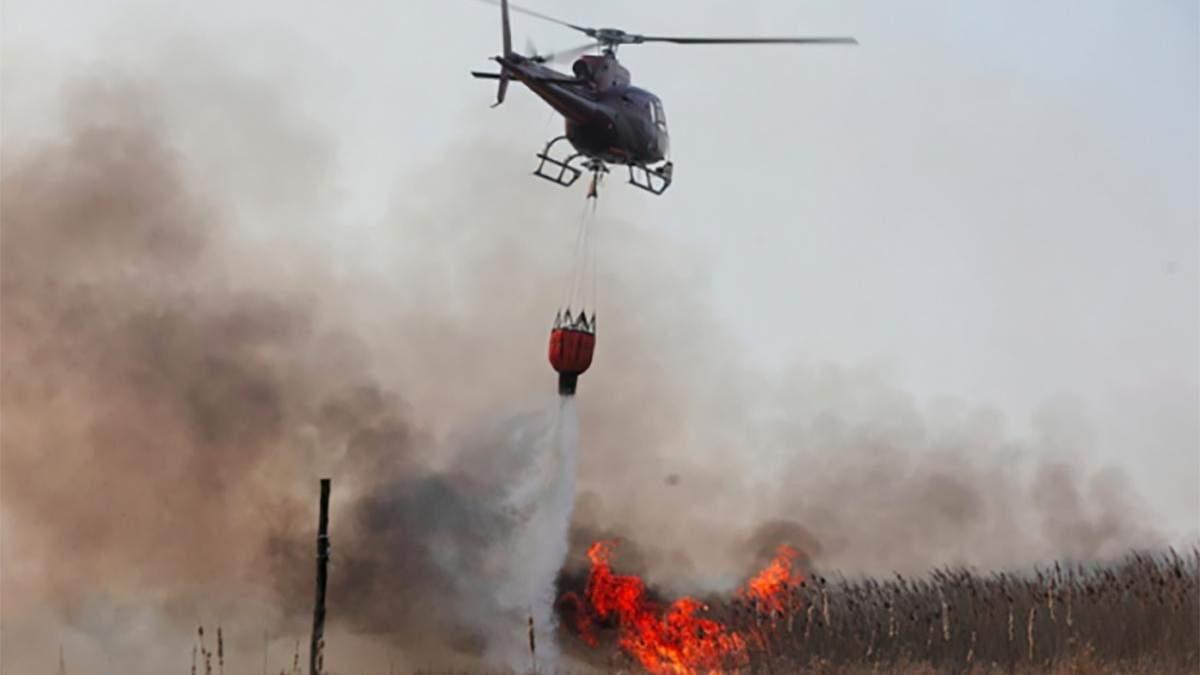 Вертольоти гасять полум'я на Луганщині