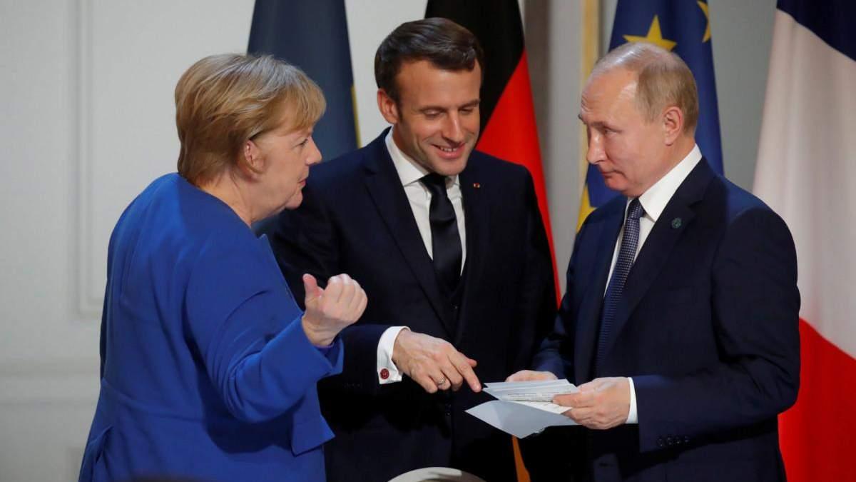 Меркель и Макрон могут шантажировать США - Печий