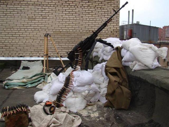 В Славянске террористы устанавливают пулеметы на крышах домов [Фото]