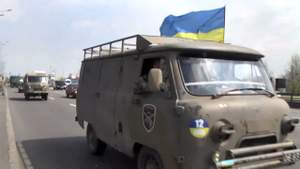 Демобилизованных бойцов 12 батальона в Киеве встречали цветами и флагами