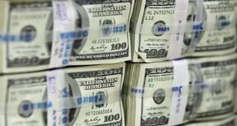 Понижение рейтинга США увеличит расходы на 100 млрд долл.