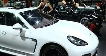 Volkswagen завершит объединение с Porsche в августе 2014