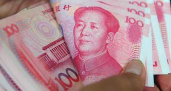 Российские компании вследствии санкций Запада переходят на юань, - СМИ