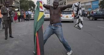 В Зимбабве празднуют отставку президента Мугабе: яркие фото из Хараре