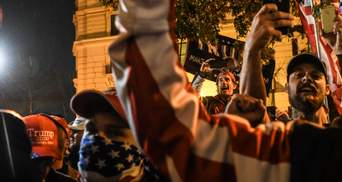 Вогнепальне та ножові поранення: у США протест прихильників Трампа переріс у сутичку –  фото