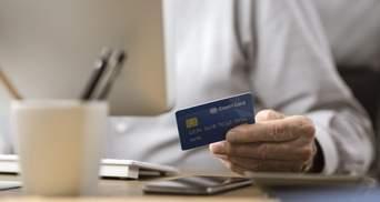 Хочеш, не хочеш – плати: банки почали списувати гроші з рахунків українців за штрафи й комуналку