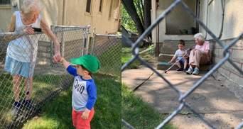 Придумали игру через забор: видео искренней дружбы 99-летней бабушки и 2-летнего мальчика