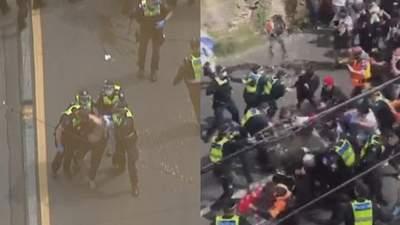 Антикарантинный протест в Австралии перерос в столкновения с полицией: эмоциональные видео