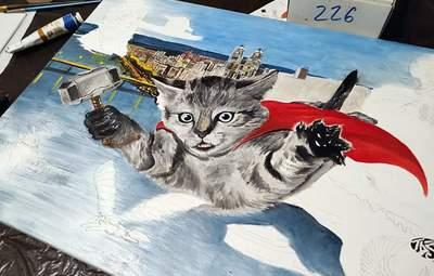 Художник из Днепра выставил картину о коте-супергерое на аукцион: как она выглядит