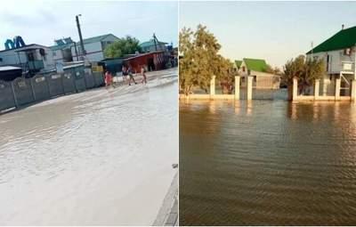 Люди ходят по колени в воде, авто тонут в грязи: в Кирилловке затопило Федотову косу