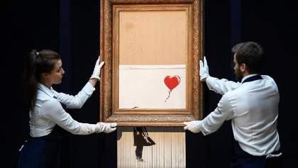 """Знаменитая картинка Бэнкси впервые появилась на выставке после """"уничтожения"""": фотодоказательство"""
