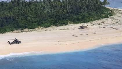 С необитаемого острова спасли людей благодаря надписи SOS на песке: фото, видео