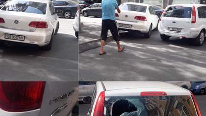 В Киеве неадекватный мужчина разбил машину ногами