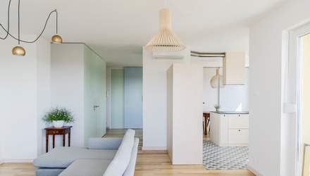Классический белый – дизайнеры перепланировали две квартиры в одну в Польше: фото и проект