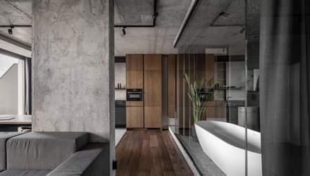 Ванна посеред кімнати та бетонні стіни – стильний інтер'єр квартири на Рибальському острові
