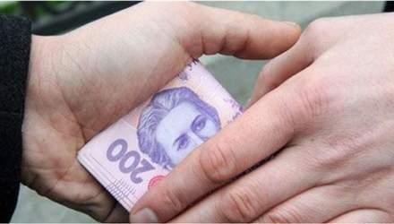 Покупал голоса за деньги: на Киевщине кандидата в главы ОТО подозревают в подкупе избиратей