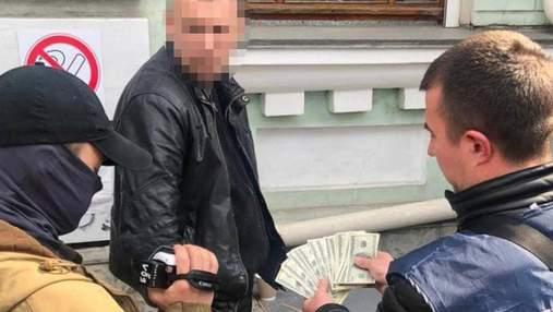 Требовал деньги за непривлечение преступников: в Киеве будут судить одного из топов полиции