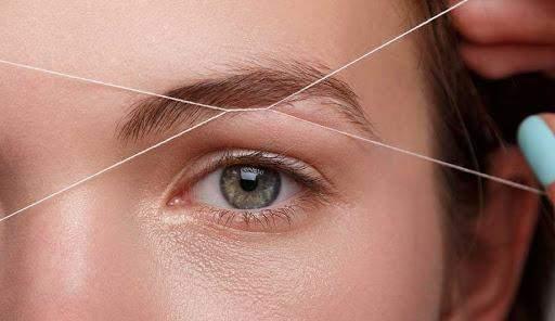 Вищипування брів ниткою