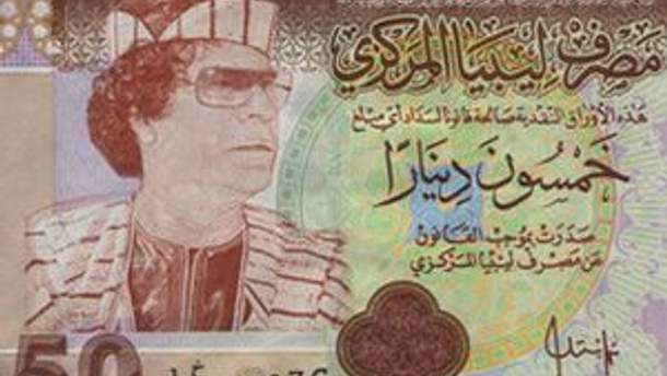 Зображення Муамара каддафі на лівійському динарі