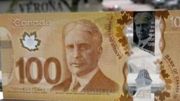100 канадских долларов