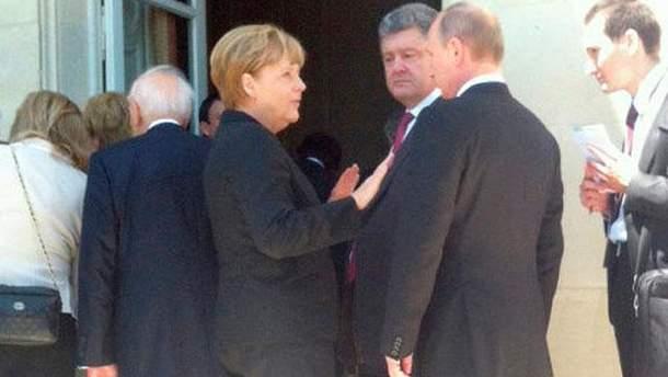 Володимир Путін, Ангела Меркель та Петро Порошенко