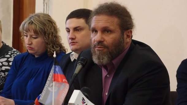 Роман Возник