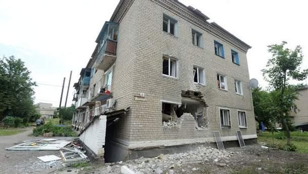 Обстріляний будинок
