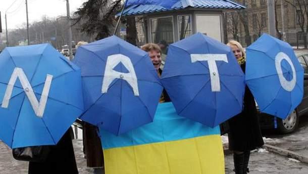 Женщины с зонтиками
