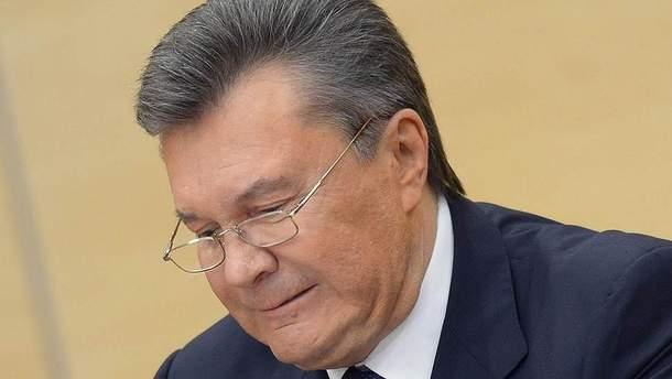 Виктор Янукович ломает ручку