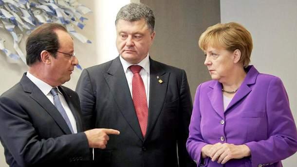 Олланд, Порошенко и Меркель обсудили провокации России