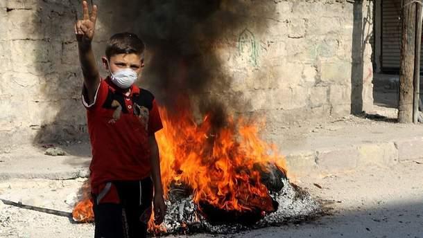 Мальчик на улице Алеппо