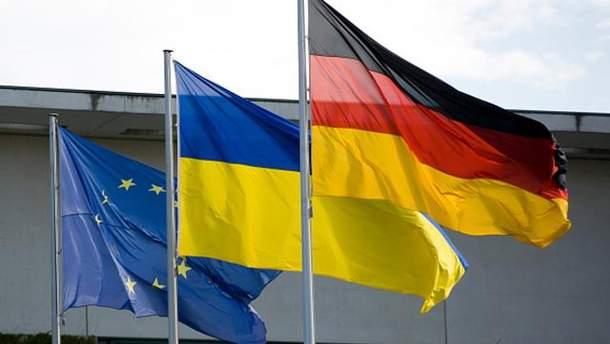 Прапори Німеччини, України та ЄС