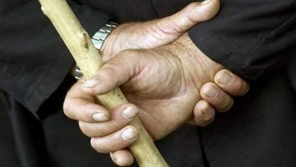 Человек с палкой
