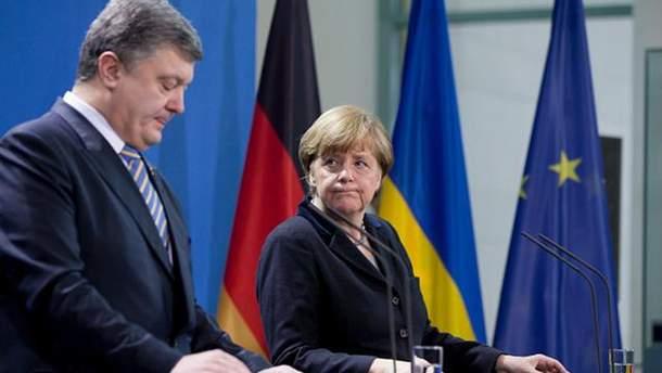 Меркель выдвинет Порошенко ряд неудобных вопросов