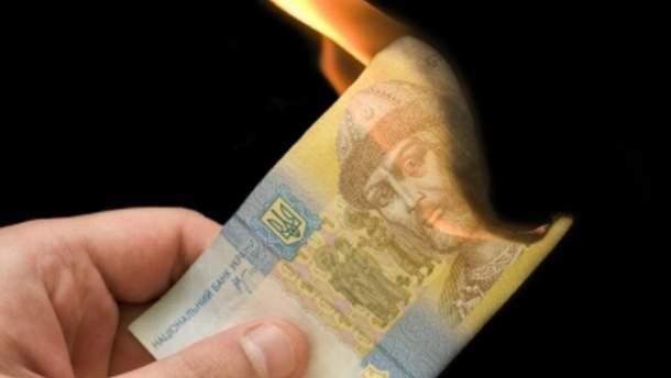 """Як українська держава """"заробляє"""" на інфляції"""