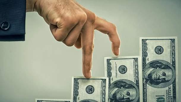 Чому росте долар