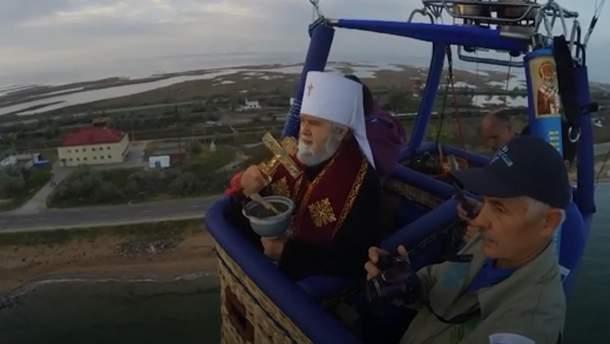 Оккупанты с неба освятили Крымский мост