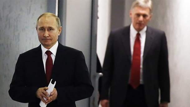Владимир Путин и его пресс-секретарь Дмитрий Песков