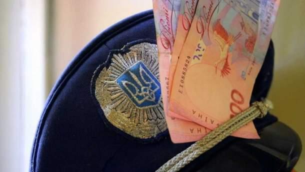 """Правоохоронці вимагали 5 тисяч доларів за таку """"послугу"""""""