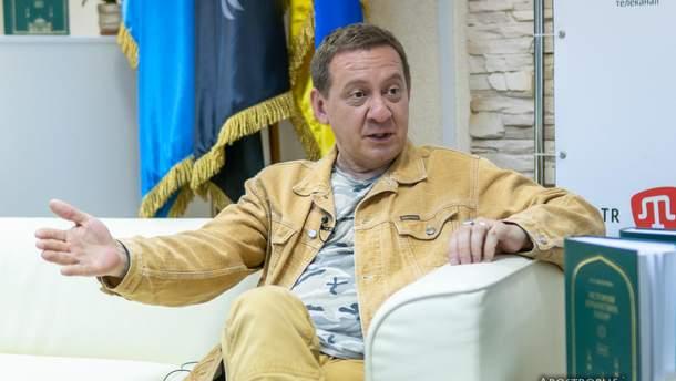 Журналист Айдер Муждабаев
