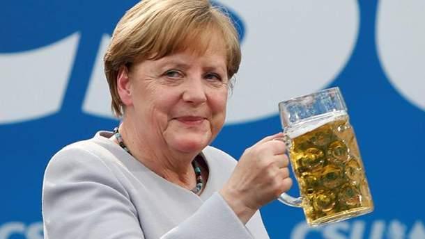 Меркель может поехать в Россию на ЧМ-2018