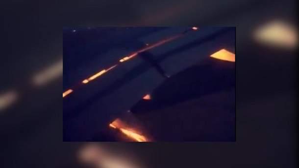 Скріншот з відео пожежі на літаку зі збірною Саудівської Аравії