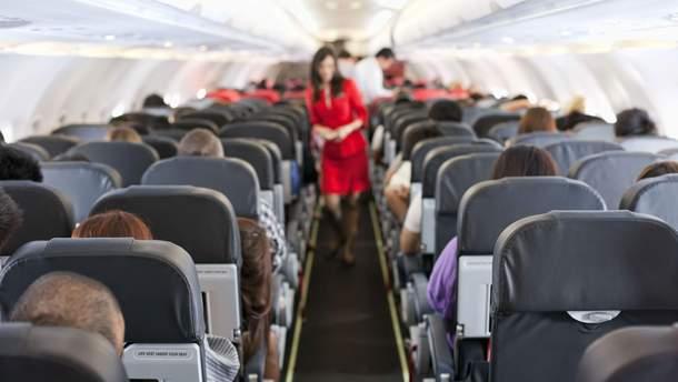 Места у прохода в самолете являются наиболее безопасными