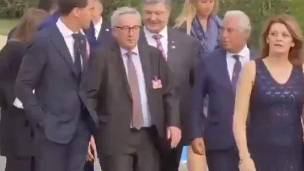 Президент Еврокомиссии Жан-Клод Юнкер с трудом держится на ногах на ужине саммита НАТО