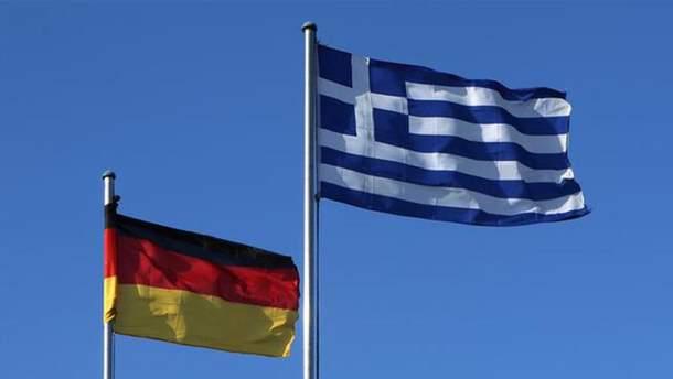 Германия и Греция достигли договоренности в отношении мигрантов
